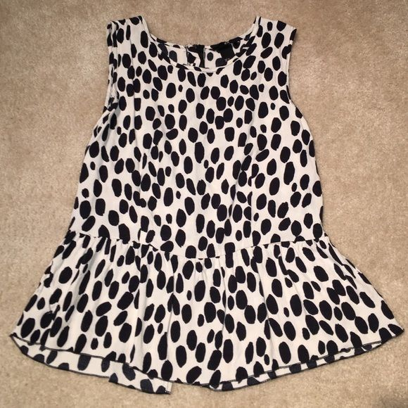 Leopard dots peplum tank! Size M White and black spotted peplum tank. H&M SIZE 12 style runs very small. I usually wear 4/6 and this fits me perfectly. H&M Tops Tank Tops