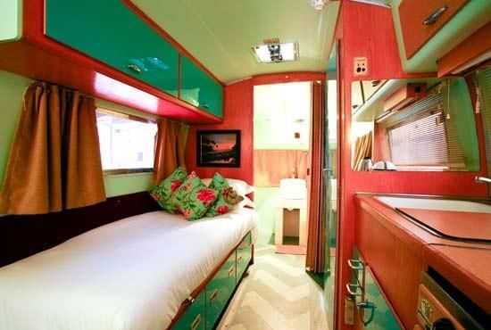 """Green & watermelon pink """"Pleasantville"""" Airstream at the Rooftop Trailer Park, Grand Daddy Hotel, Cape Town, South Africa."""