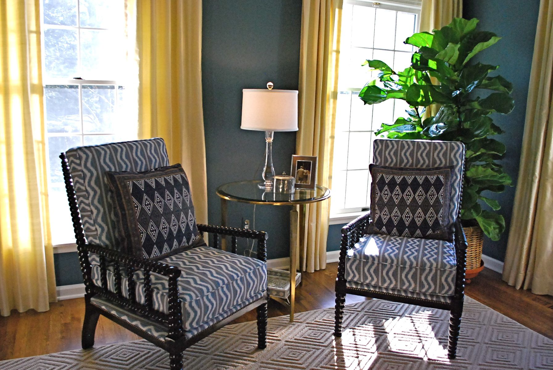 Indigo walls bobbin chairs with ikat fabric and African cloth