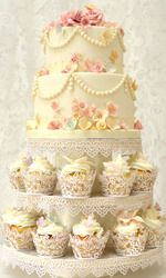 A combination of cake and cupcakes with a vintage theme.