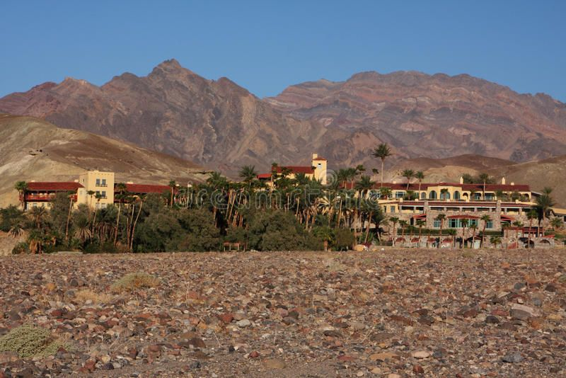 Desert oasis oasis with buildings in the middle of the