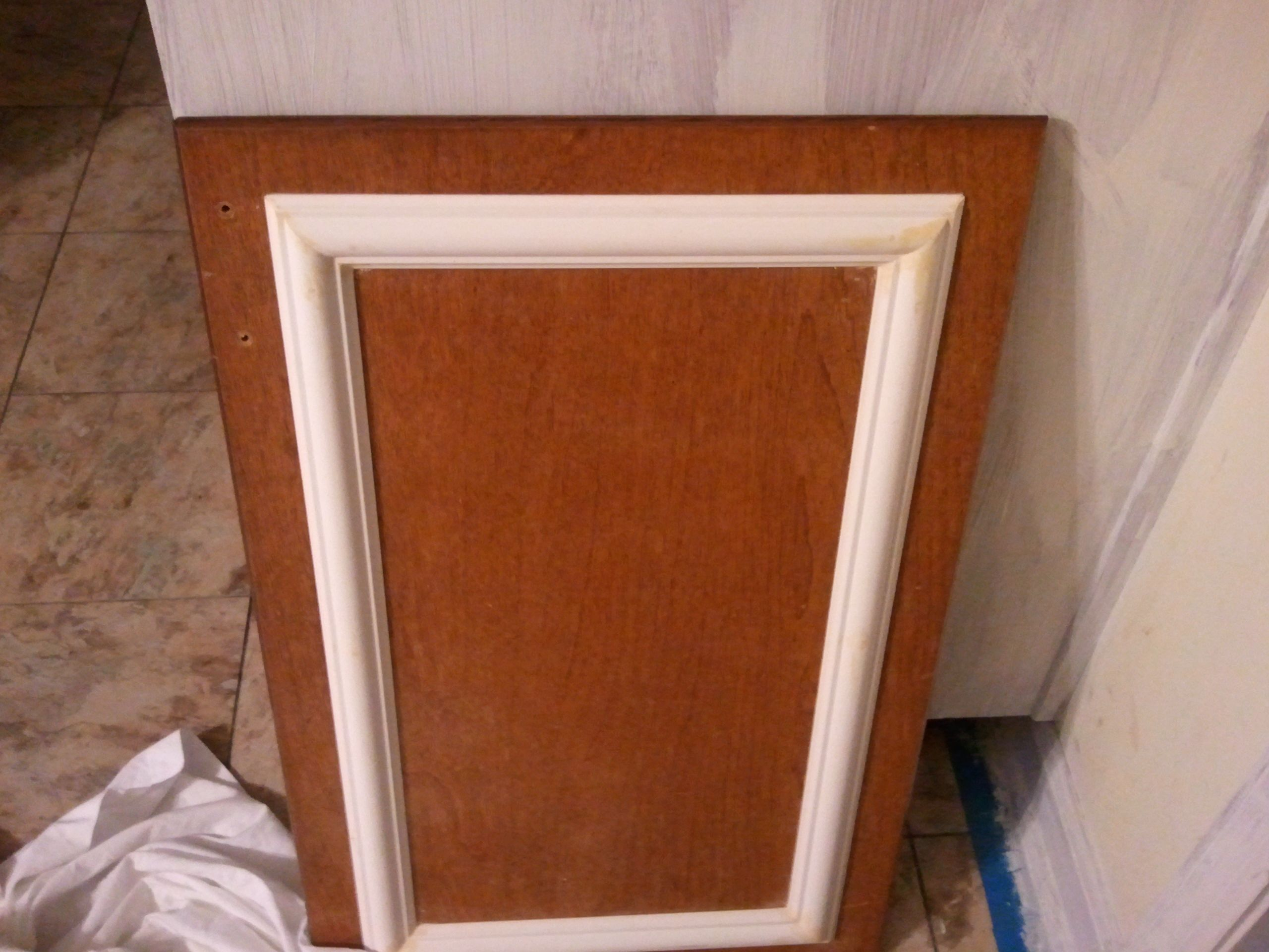 Wood Veneer Cabinet Doors Add Trim And A New Coat Of Paint To Old Cabinets For A Chic Update