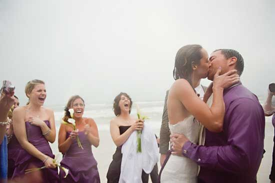 A hurricane couldn't keep their day from happening! Takes kissing in the rain to a whole new level ;)