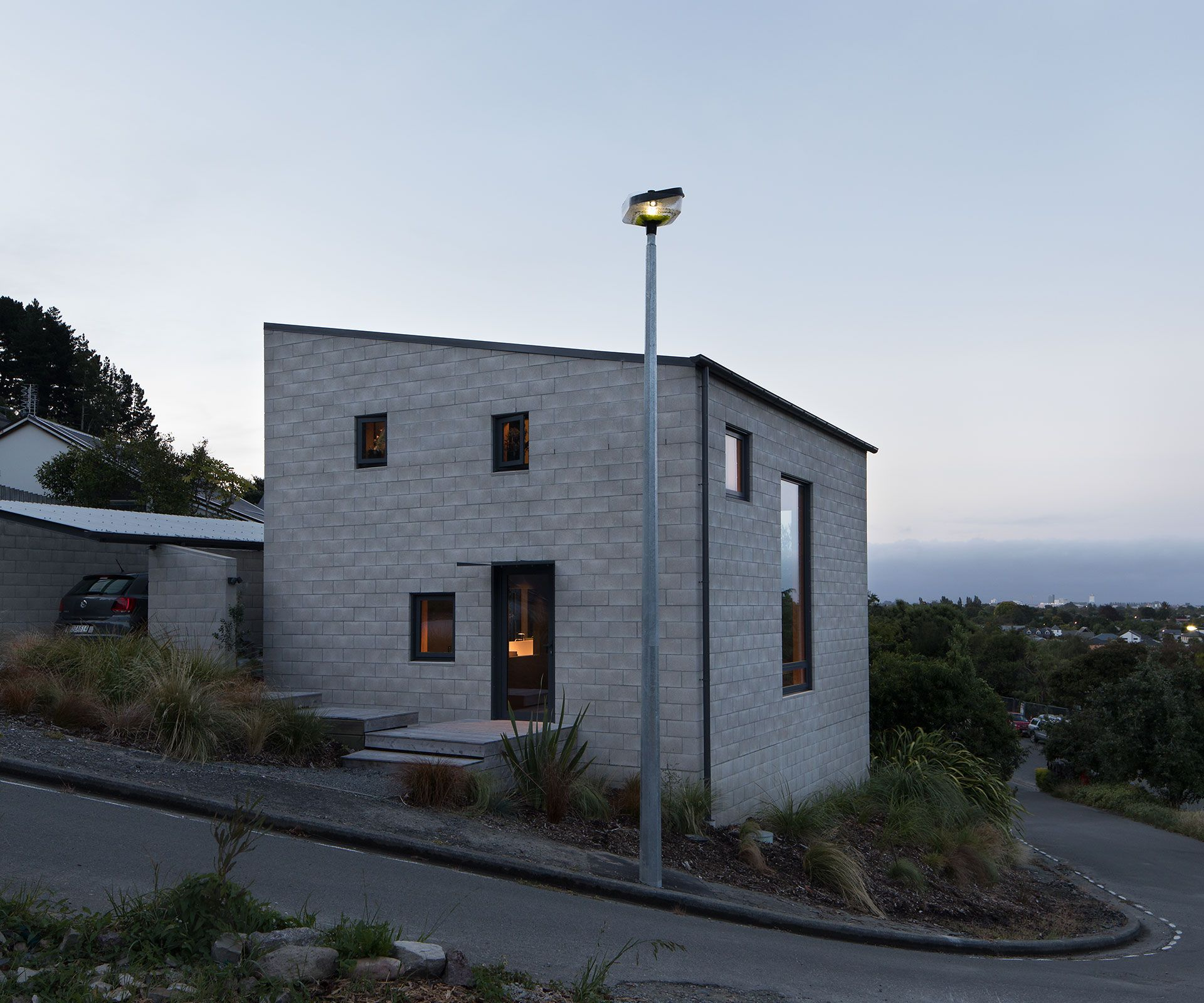 A compact concrete house is named new zealand s best small home
