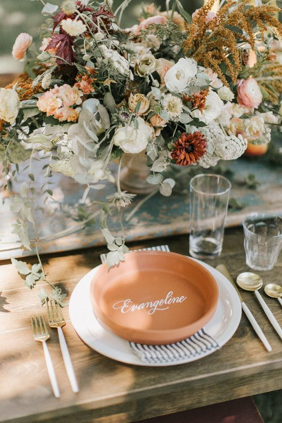 For visuals of the terracotta plate on top of the charger  I don't like this particular terracotta bowl as it looks like the plate that goes under a pot  is part of Wedding place settings -