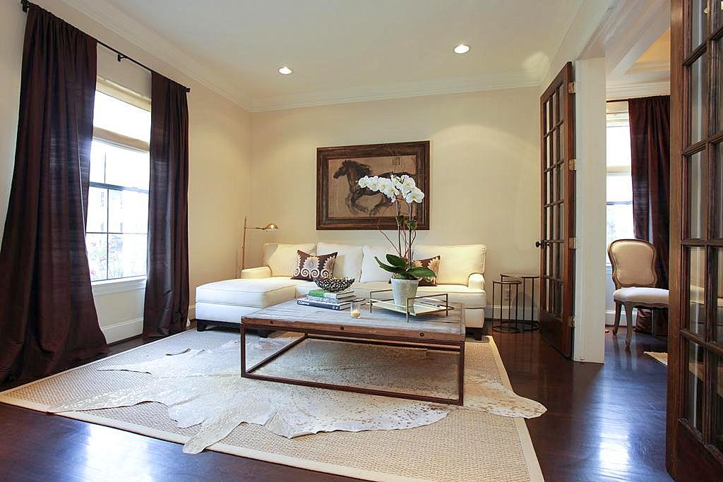 Living Room Jute Rug formal living room // white cow hide on large jute rug | project d