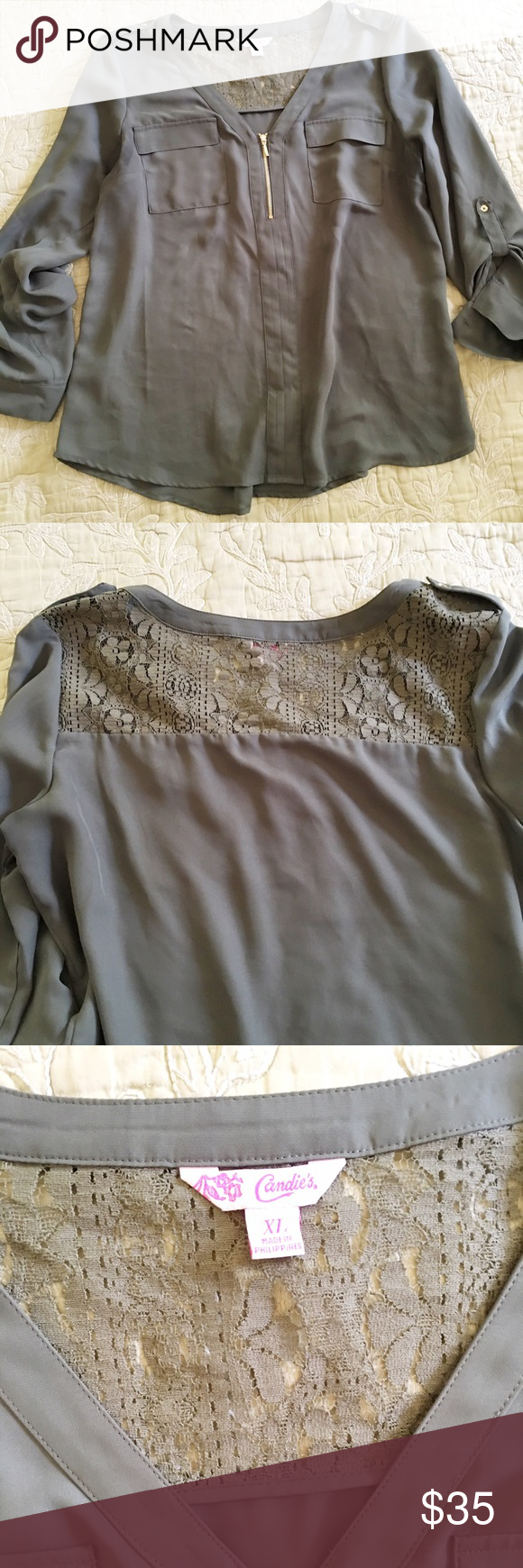 Candies Blouse Worn twice. Lace yoke in the back. Equipment sleeves (buttoned up or worn down) 1/2 zipper. Army green with gold accents. Size XL. Fit more like a L. Small stain in the back (see photo) washable. Candie's Tops Blouses