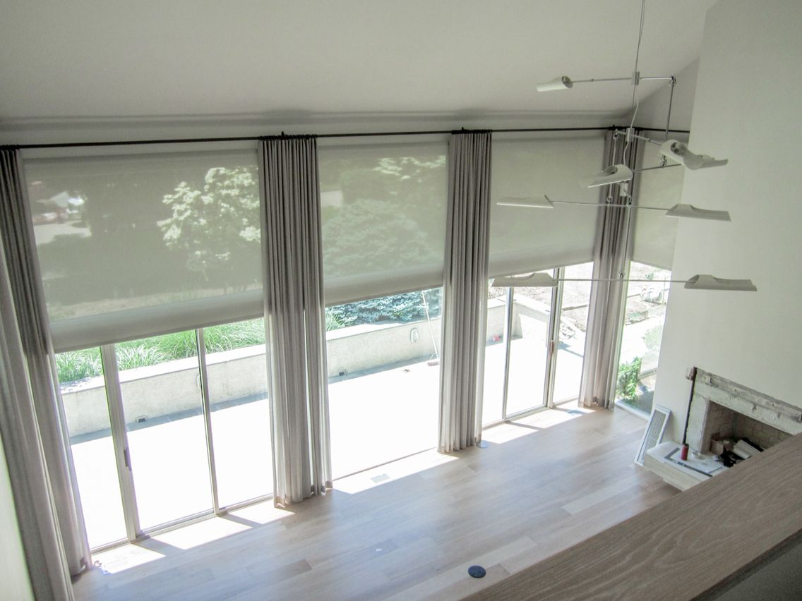 motorized sheer white solar shades and tall tan drapery