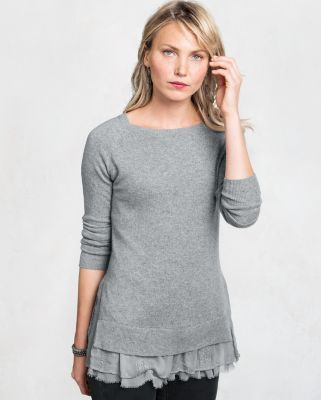 cb14058162 This shirttail cashmere sweater features the surprise of lace peeking out  from the hem. The