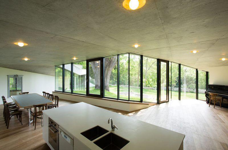 Bien-aimé Parfaite intégration pour cette extension semi-enterrée à toiture  YY96