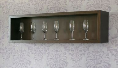 neat idea for back bar shelves - but display bottles, not glasses.  Would need uplighting somehow..