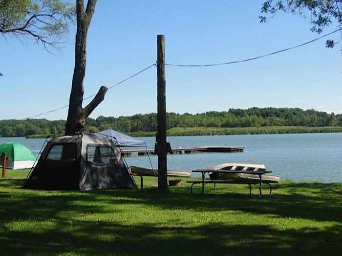 The traditional camper can set up a tent near the lake and ...