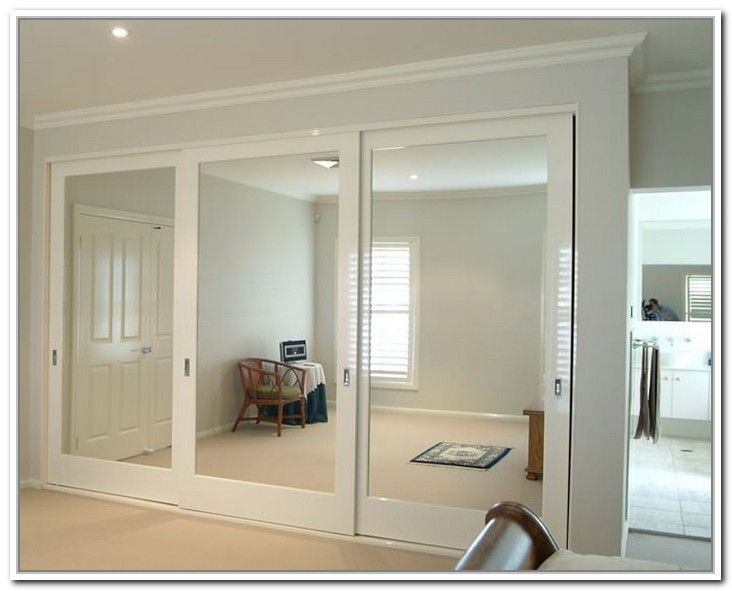 Sliding Mirror Closet Doors Makeover i would repaint the door a white to match my new room color. only