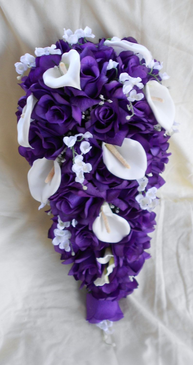 Cascade bride bouquet royal purple and white roses lilies