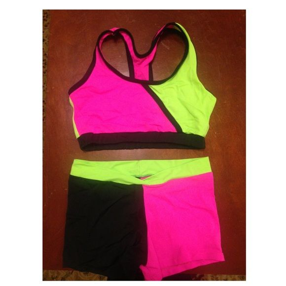 Balera Danceware set Green, Black, and Pink Danceware set. Racerback sports bra and dance shorts. There is a little bit of the stitching coming out of the shorts but it isn't noticeable Balera Shorts