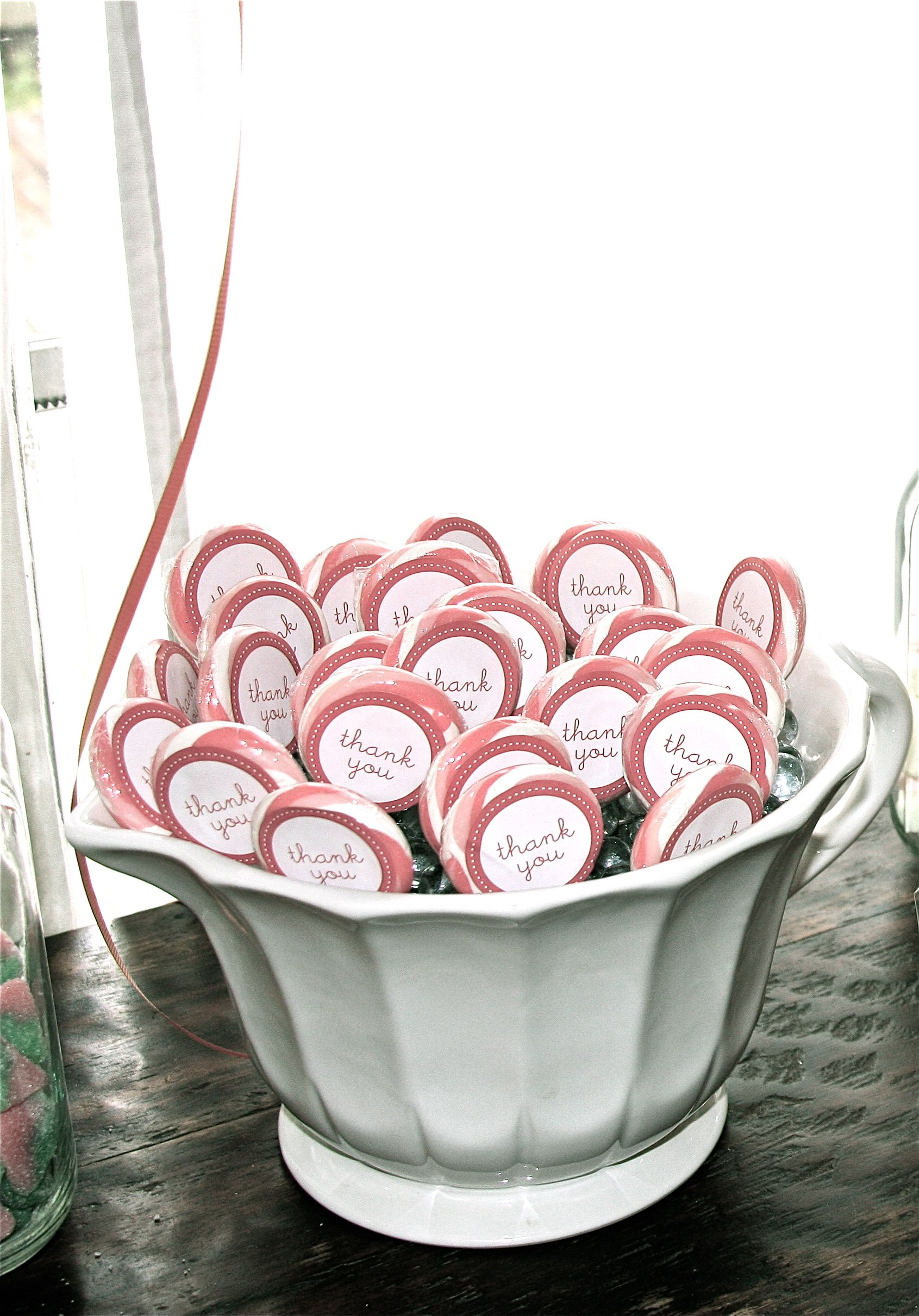 large tea cup with lollipops