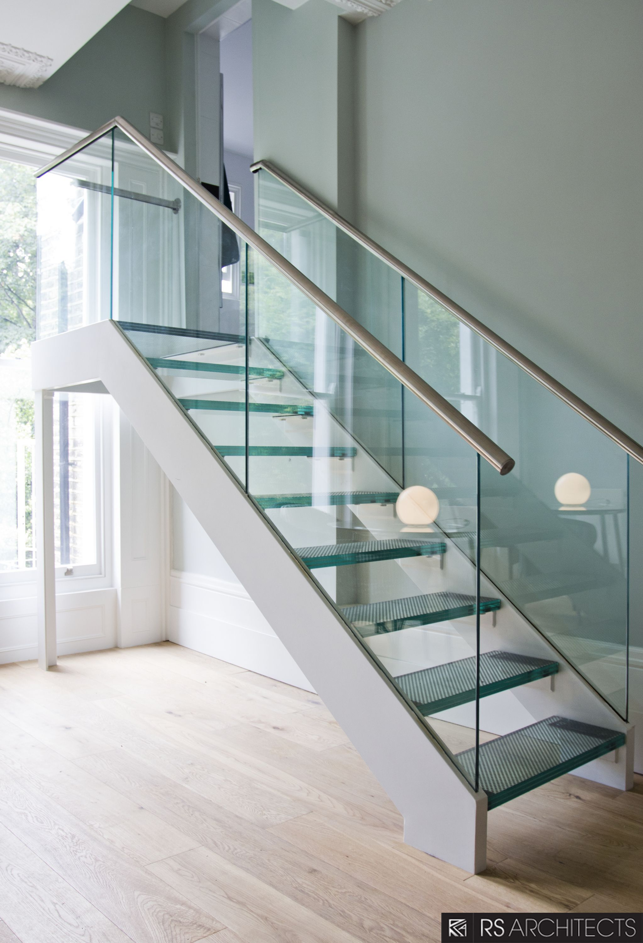 picturesque double chrome handrail with glass balustrade and landing glass stairs in modern open plan interior - Wall Railings Designs