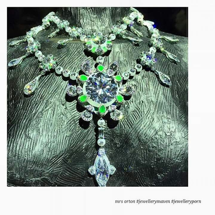 "'A Heritage in Bloom,"" a necklace made of green and white jade, colored diamonds and 24 D-color, internally flawless diamonds from the original rough. The centerpiece of the necklace is the largest diamond in the suite: a 104-carat, D color, internally flawless, brilliant round diamond with the highest possible cut grade of ""3-Excellent,"" according to the Chow Tai Fook, making it one of the largest diamonds ever with these characteristics. Image from @ac_kaf"