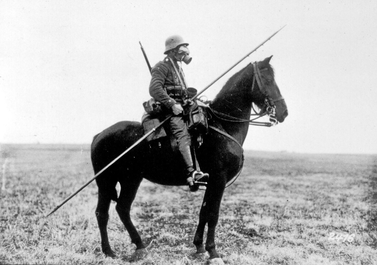 german soldier with a gas mask and a spear riding horse