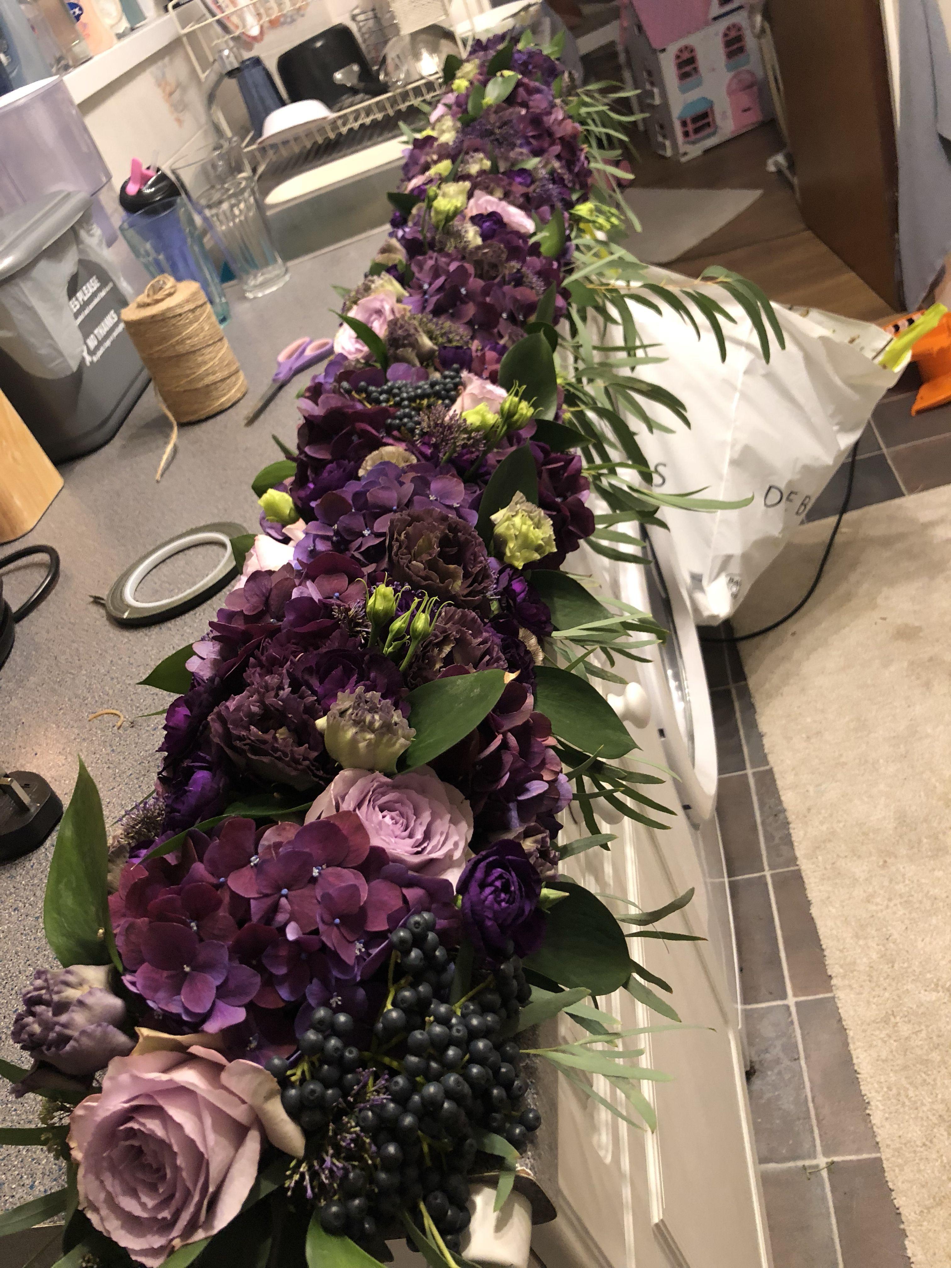 Mixed Shades Of Purple In This Top Table Garland Purple Wedding Centerpieces Wedding Flower Alternatives Purple Flower Centerpieces