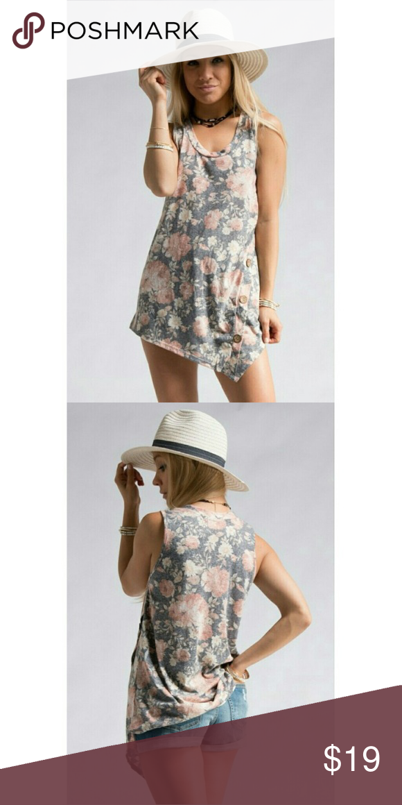 Diagonal bottom floral print sleeveless top NEW boutique top that has a muted black/charcoal background, blush floral design with a side button detail. Super flattering fit! 50% polyester, 12% rayon, 38% cotton. Made in the USA 🇺🇸 bundle and save! Tops Tank Tops