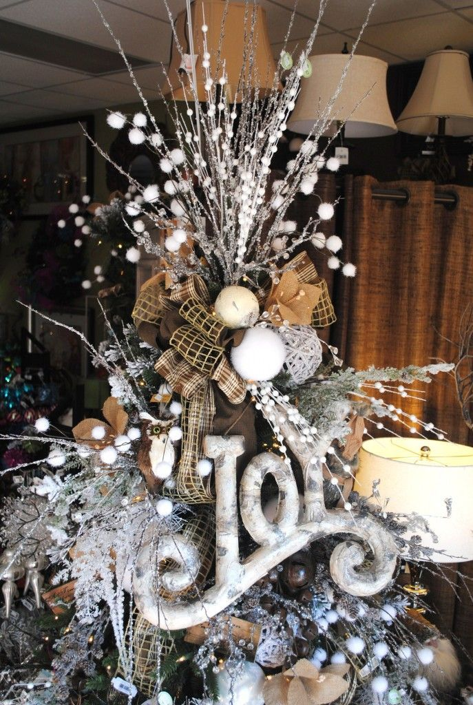 Twigs Burlap Styrofoam Balls And Ribbon Combined In A Detailed Tree Topper Unusual Christmas Trees Christmas Tree Decorations Christmas Decorations