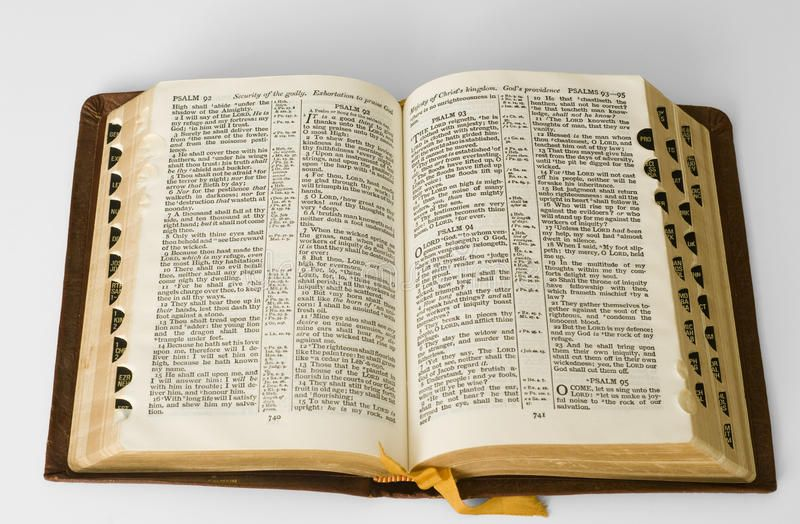 Open bible. An old leather bound bible open to a chapter of Psalm ...