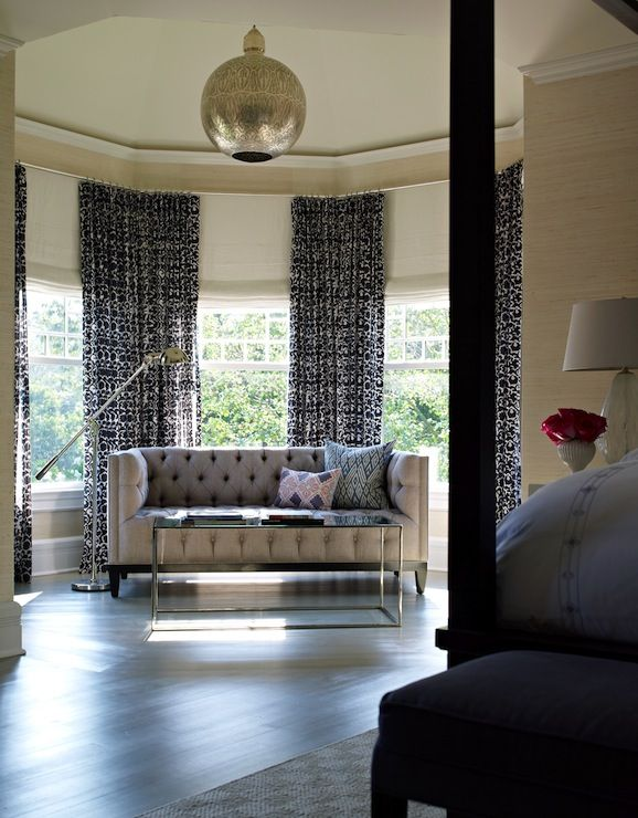 Spacious Sitting Area In Bedroom With Gray Tufted Modern Sofa In