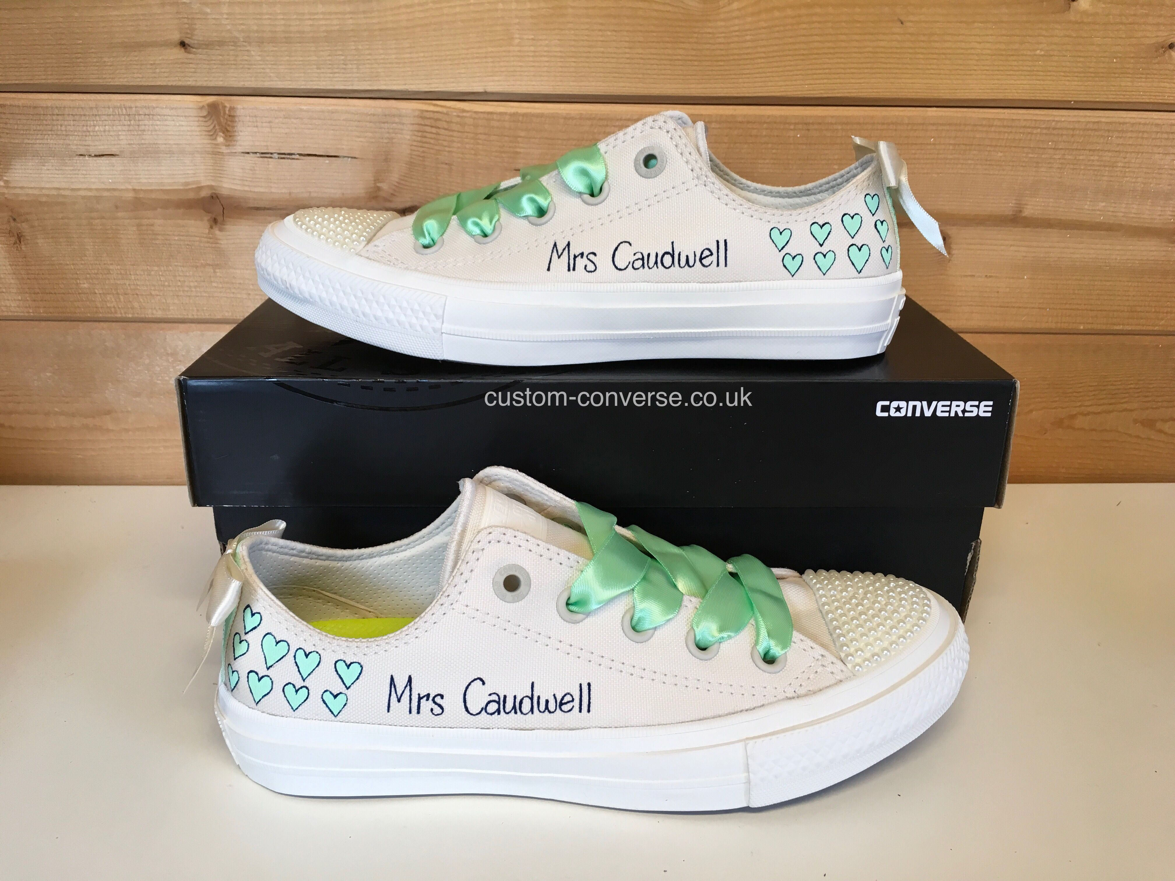 abb175f68af1 Chuck 2 ivory Wedding Converse with Hearts design and ivory bows.   weddingconverse