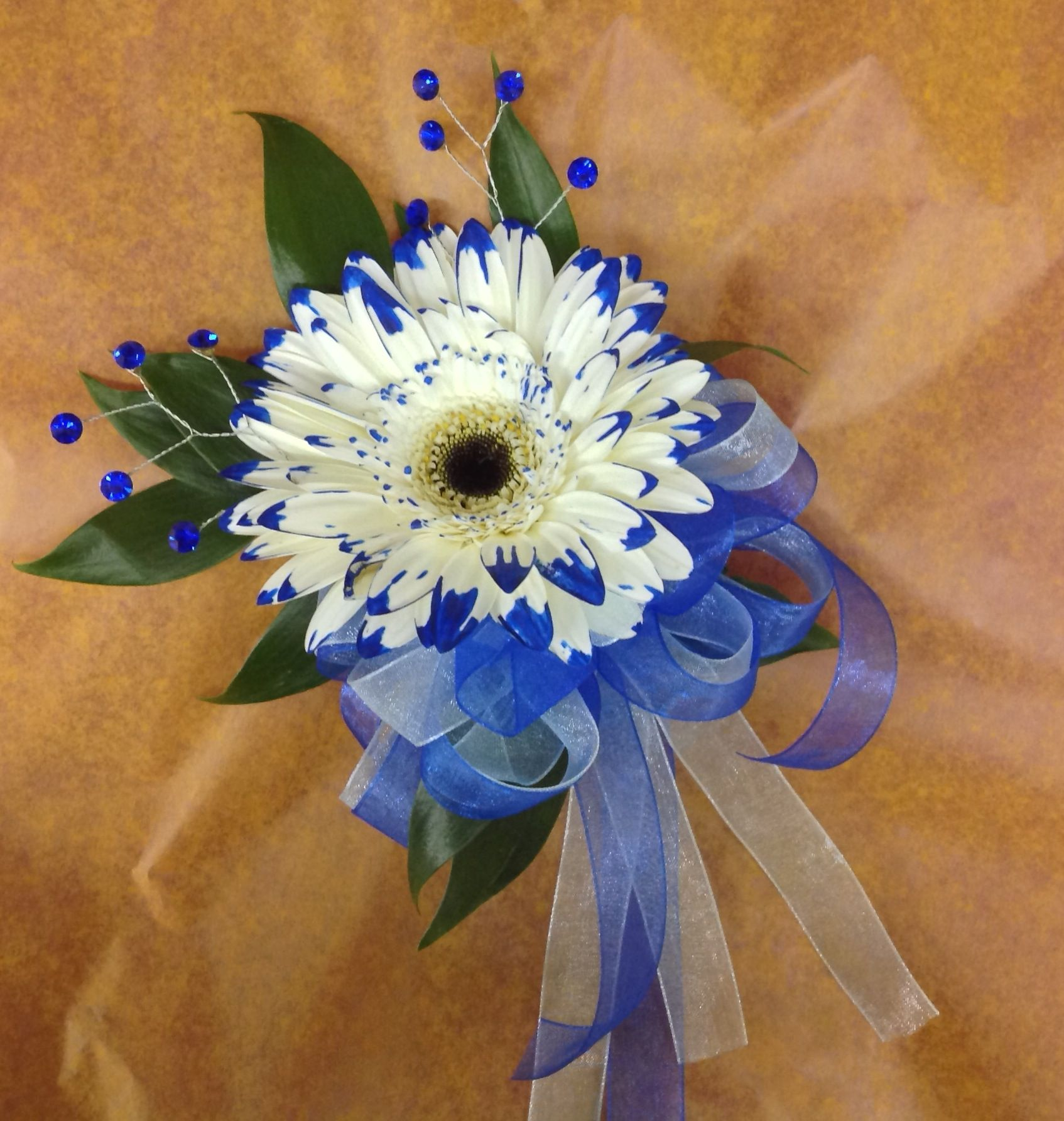 Blue white wrist corsage with gerbera blue ribbons and blue blue white wrist corsage with gerbera blue ribbons and blue rhinestone accents homecoming izmirmasajfo