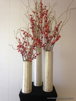 Three Tall Centerpieces Of Red Berries And Twigs In Silver Zodiac