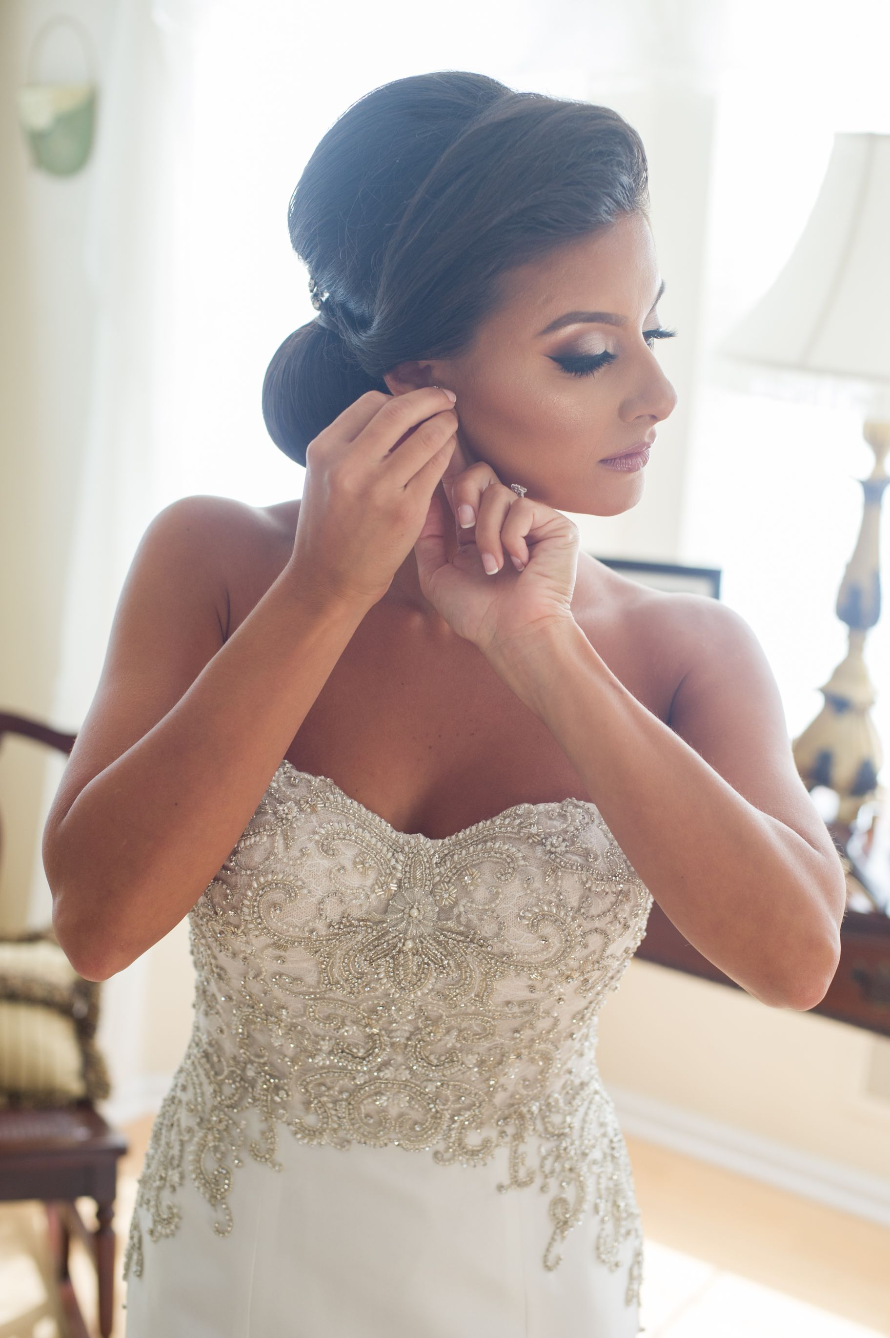 Picture perfect bridal makeup and styled updo for the bride to be