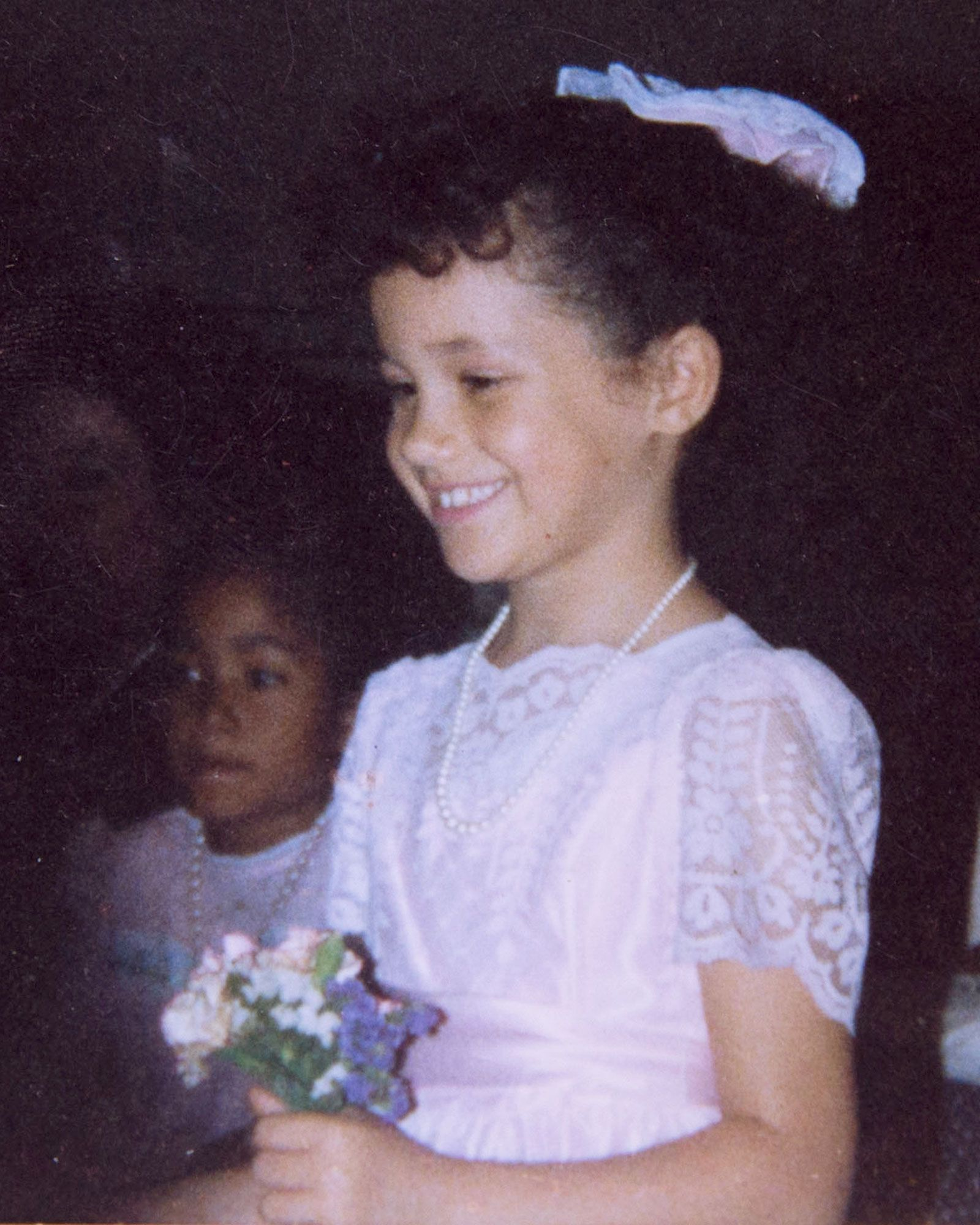 See A Young Meghan Markle As An Adorable Flower Girl At