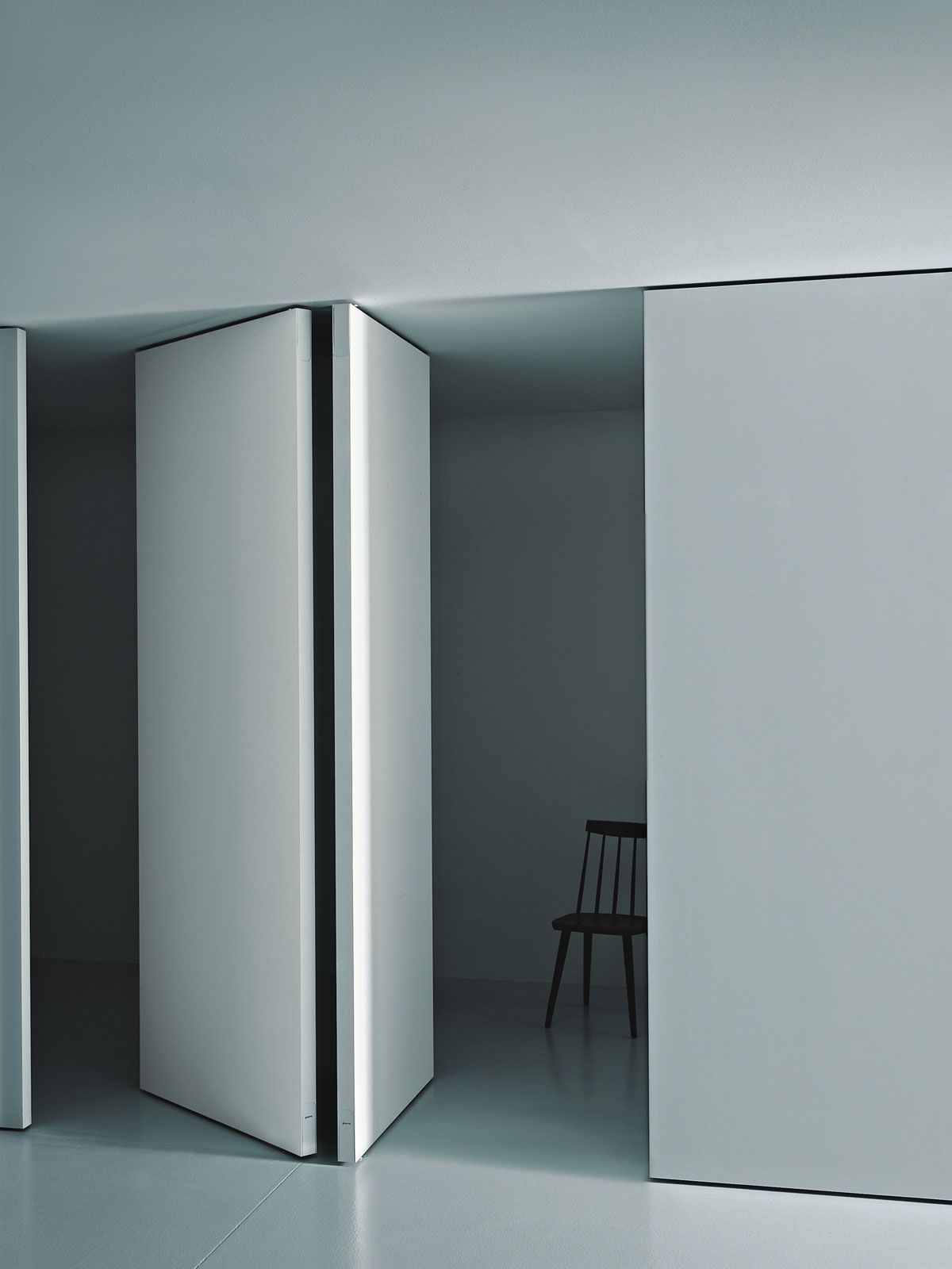 Partition wall pivot by porro white minimal white for Wall partition design photos