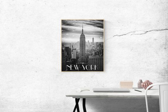This digital print design features a beautiful black and white photograph of the Empire State Building in New York City. Using a simple font the essence of New York City is captured perfectly. This Empire State Building Print can be showcased in any room of your home. Add it as a statement piece in your office or build a gallery wall with your favorite pictures from a visit to the Big Apple.  Check out all of the City Skylines Line here…