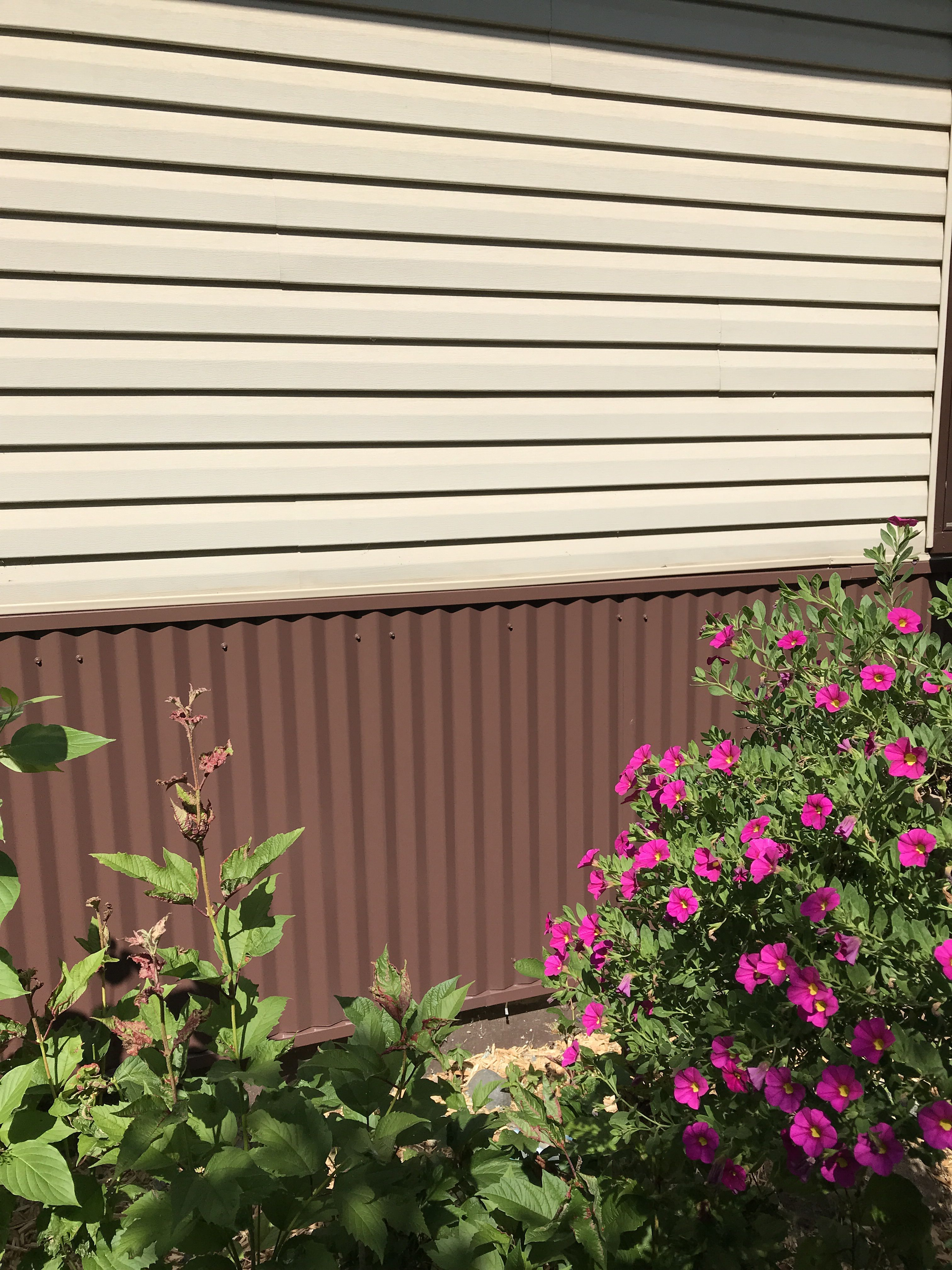Best Replaced Vinyl Brick With Brown Corrugated Metal This 400 x 300