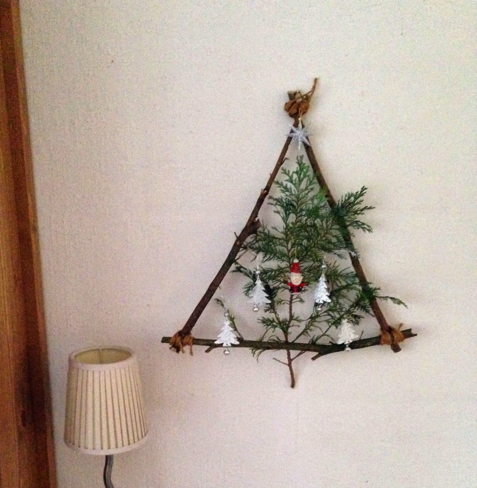 hi guys heres a quick cute idea how to decorate that empty space on your wall christmas style all you need are some twigs a littl