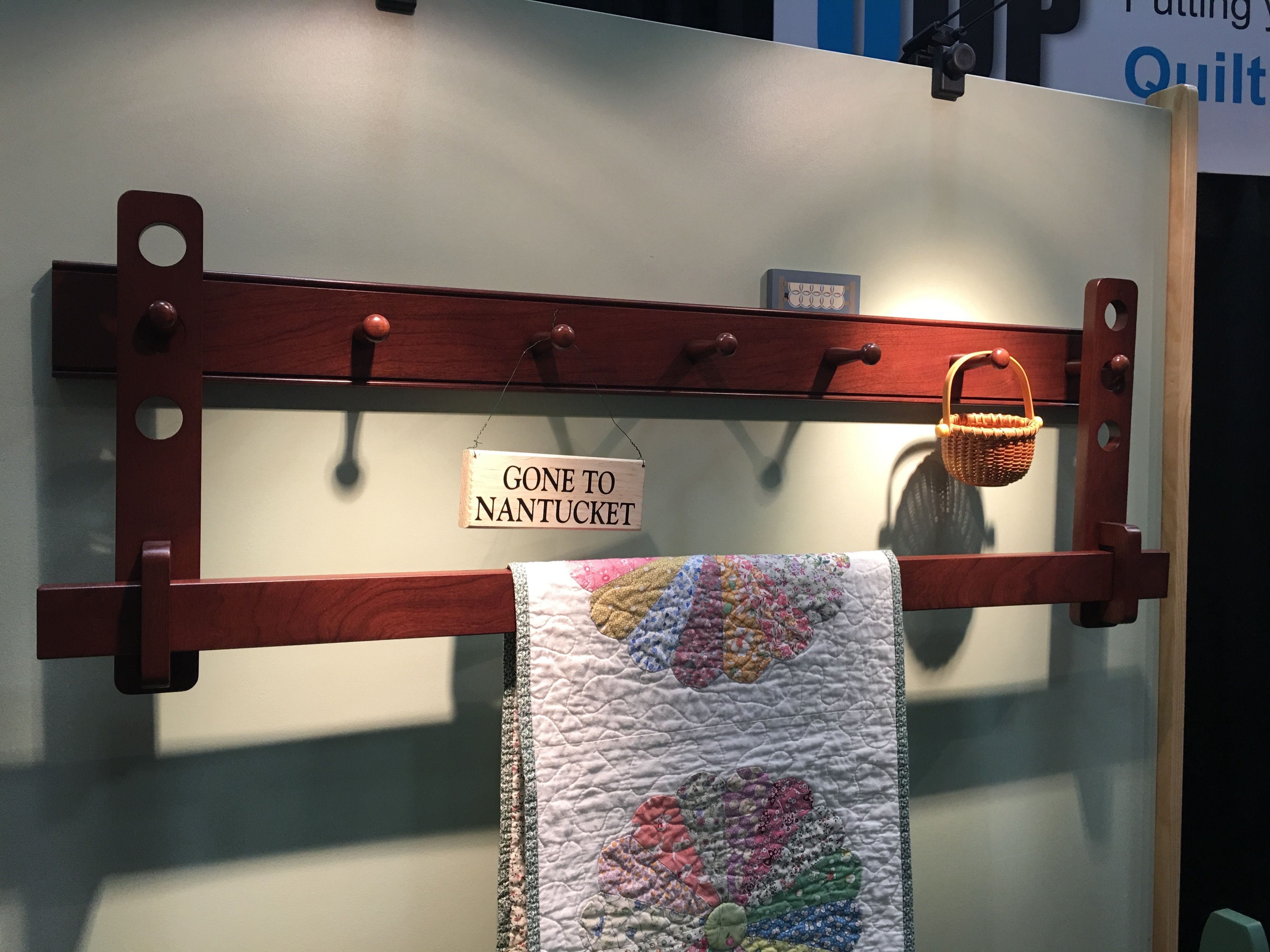 Shaker Style - Adjustable Peg Rail - Hang your favorite quilt on one of our wall shelves or racks. Your quilts can be used with or without a sleeve. Shelves hold small items for display, and racks allow you to make width and height adjustments.