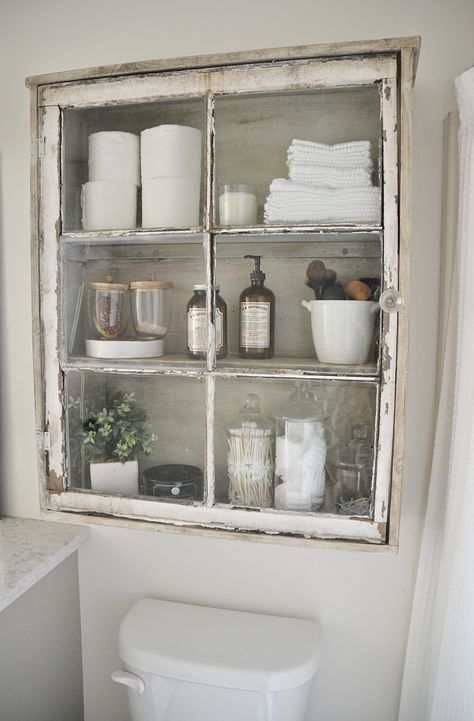 ways to repurpose old windows - turn a window into a wall cabinet for the bathroom, via Liz Marie Blog