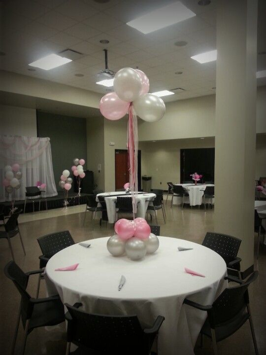 Floating balloon centerpiece. Add different colors of ribbon and tulle for an extra special effect.