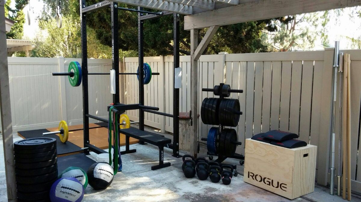 Outdoor home rogue fitness gym squat rack kettle bells home gym