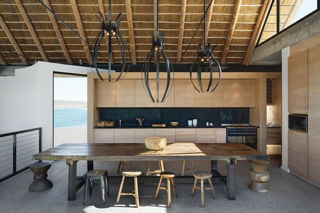 The kitchen cabinets are made from lime-washed oak A + A