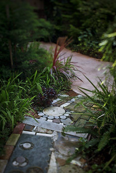 Love sticking all the found objects in a pathway.....could be really special.  @ Margie Barnett