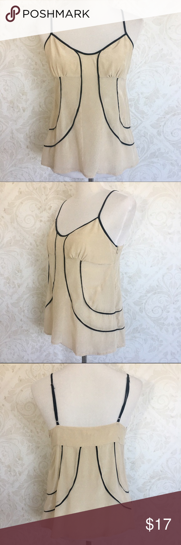 silence + noise 100% silk camisole Light as a feather. Pure cream colored silk with flattering black piping and adjustable straps. Hidden side zipper. Worn once or twice--no signs of wear; in excellent condition. silence + noise Tops Camisoles