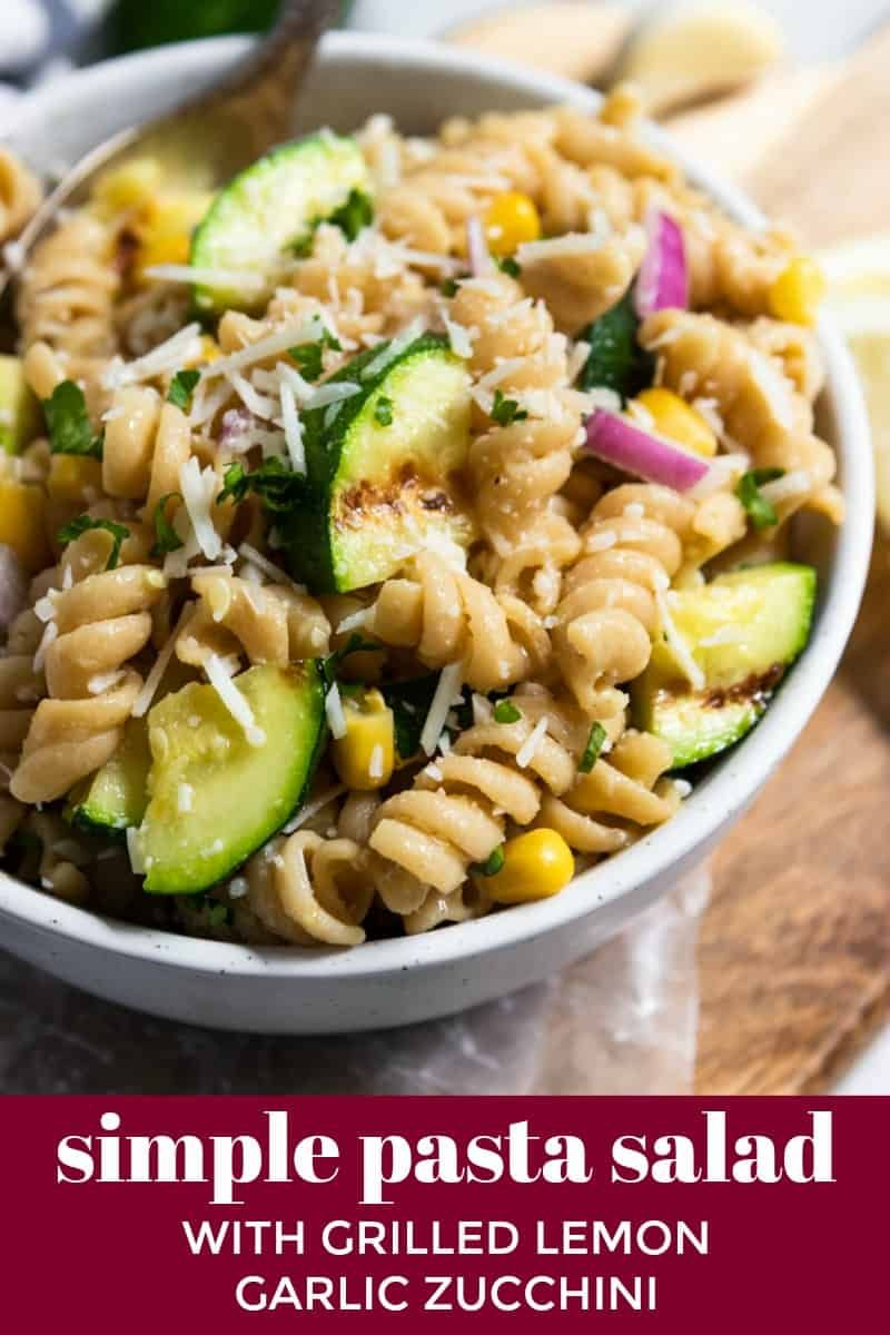 Simple Pasta Salad with Grilled Lemon Garlic Zucchini Summer in a bowl in this Simple Pasta Salad with Grilled Lemon Garlic Zucchini right here! The lemon gives a fresh burst of flavor along with the corn, parmesan, and zucchini. Make this a side dish for the BBQ or top with chicken for a full summer dinner. This recipe will become your new favorite!