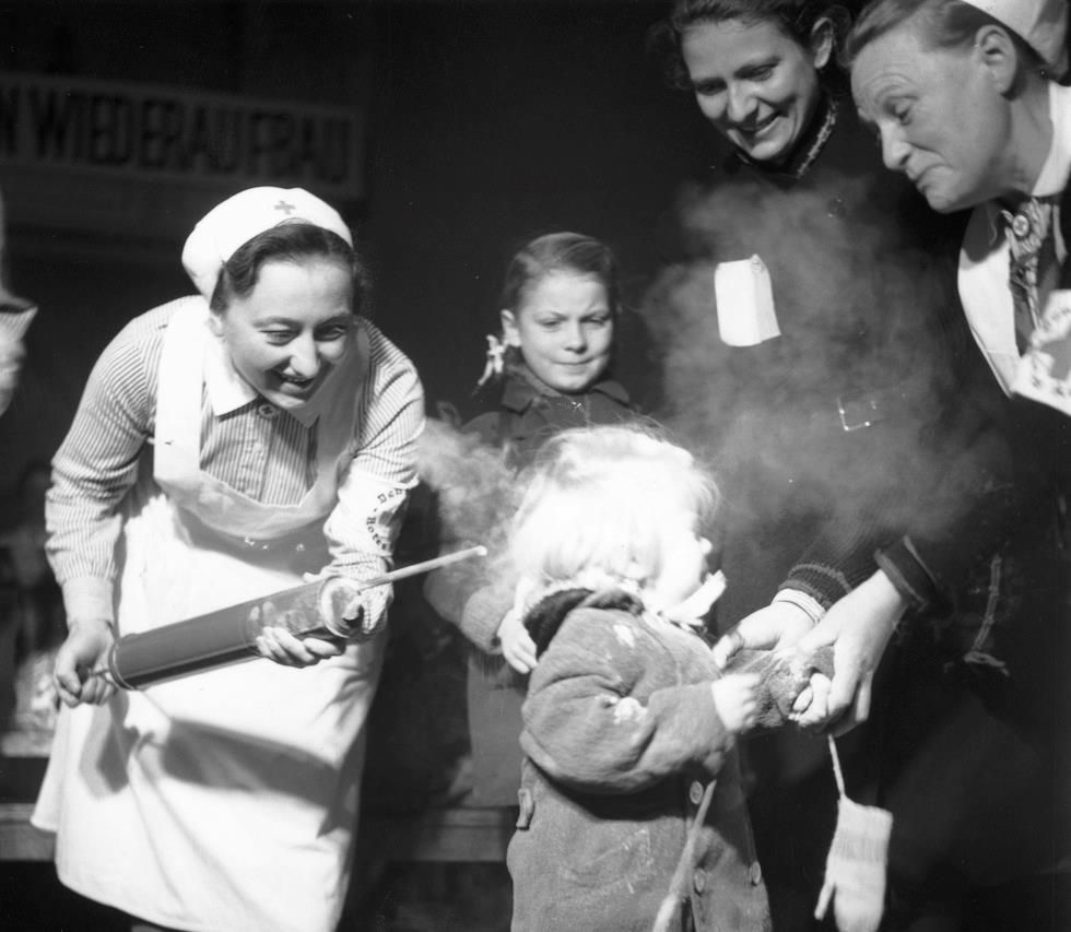 Oct 1945 A Child Crying As She Is Sprayed With Ddt