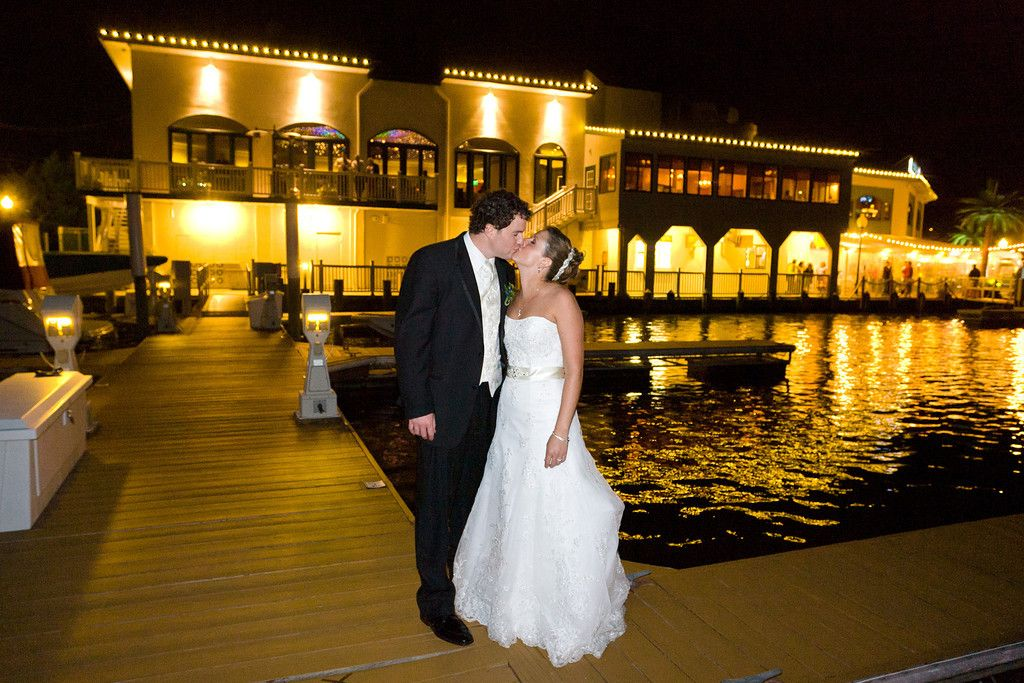 Bride And Groom On The Docks In Front Of Chesapeake Inn City