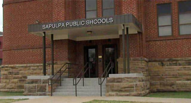 """A sign at an Oklahoma school system's administration building has the word """"schools"""" misspelled.    One neighbour says it's not a big deal, but it's been that way for months."""