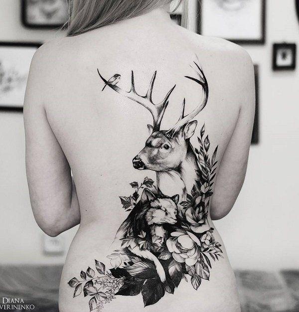 e1bbe262846ef Deer with flower back tattoo - 45 Inspiring Deer Tattoo Designs <3 <3
