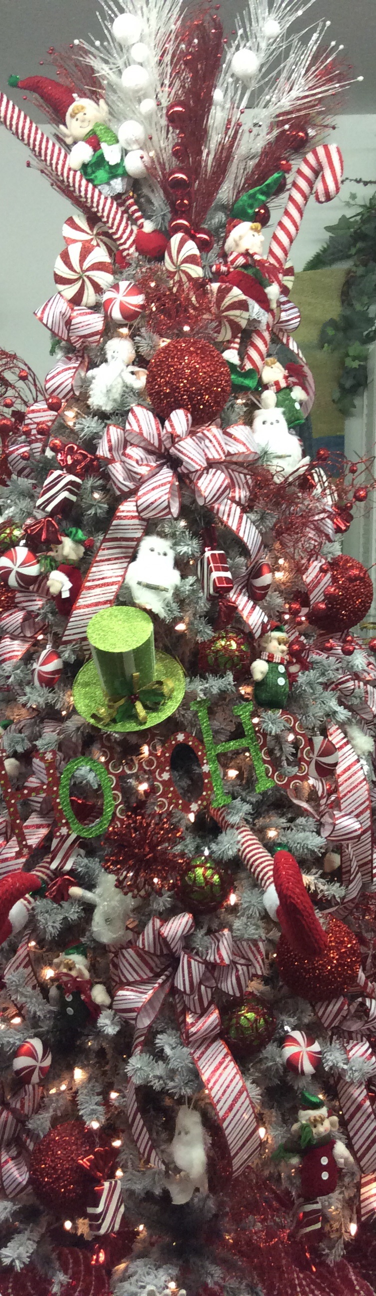 This candy cane ribbon and many other items on this tree available at tfloralsupply.com or call them at 606-639-9400 and get it shipped to you